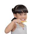 Little asian cute girl brush teeth on white background Royalty Free Stock Photo