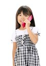 Little asian girl calling by phone Royalty Free Stock Photos