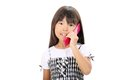 Little asian girl calling by phone Royalty Free Stock Image