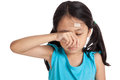 Little asian girl cry with bandage on forehead