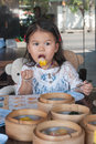 Little asian girl eating cute is lunch in chinese restaurant Royalty Free Stock Photos