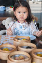 Little asian girl eating cute is lunch in chinese restaurant Royalty Free Stock Images