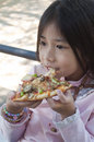 Little asian girl enjoy pizza eating Stock Images