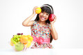 Little asian girl with fruit happy sitting on the table plate of Stock Photography