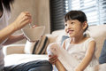 Little asian girl having breakfast with her mother Royalty Free Stock Photos