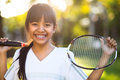 Little asian girl holding a badminton racket closeup cute outdoor Royalty Free Stock Image