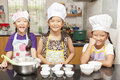 Little asian girl making cotton wool cake Royalty Free Stock Photo