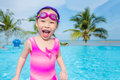 Girl in pink swim suit smiling in swimming pool Royalty Free Stock Photo