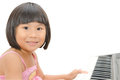 Little Asian girl play on digital piano Royalty Free Stock Photography