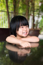 Little asian girl portrait of sitting outdoor Royalty Free Stock Photography