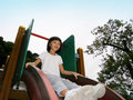 Little asian girl on slide Stock Images