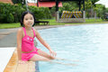 Little asian girl in swimming pool portrait of Royalty Free Stock Photo