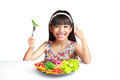Little asian girl with vegetables food isolated over white Stock Photo