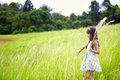 Little asian girl walking outdoors in a meadow outdoor portrait Stock Photography