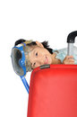 Little asian girl wearing snorkel and mask near a big travel red suitcase with space above for put text in white background Royalty Free Stock Photography