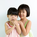 Little asian girls portrait of two sister kids over white background Royalty Free Stock Photography