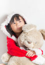 Little Asian little girl in santa costume waiting for Christmas Royalty Free Stock Photo
