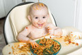 Little b eating her dinner and making a mess Royalty Free Stock Photo