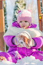 Little babe girl playing on the winter playground. Royalty Free Stock Photo