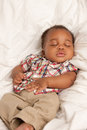 Little baby african american boy sleeping closeup of month old in cradle Stock Photography
