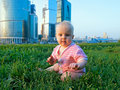 Little baby in a big city Royalty Free Stock Photo