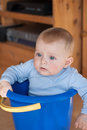 Little baby boy in blue bucket indoor Stock Photography