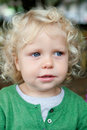 Little baby boy with curl hair and blue eyes Royalty Free Stock Photo