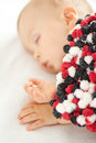 Little baby boy sleeping covered with colorful blanket Royalty Free Stock Image