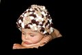 Little baby boy sleeping with hat on a black background Royalty Free Stock Image