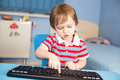 Little baby boy typing on computer keyboard Royalty Free Stock Photo