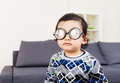 image photo : Little baby boy wear thick glasses