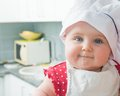 Little baby in a chef s hat cute the kitchen Stock Image