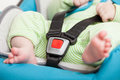 Little baby child in safety car seat fastened with security belt Stock Images