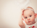 Little baby in christmas clothes and aureole Royalty Free Stock Photo