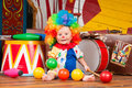 Little baby clown with red nose multi-colored wig in with balls Royalty Free Stock Photo