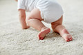 Little baby in diaper crawling on floor at home Royalty Free Stock Photo