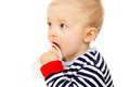 Little baby get wet wipes, and wipes his face Royalty Free Stock Photo
