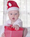 Little baby with a giftbox cute red present Stock Photo