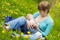 Little baby girl breast feeding Royalty Free Stock Photography