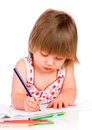 Little baby girl draws pencil isolated on white background Royalty Free Stock Photography