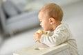 Little baby girl eating yellow apple Royalty Free Stock Photo