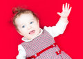 Little baby girl in festive dress singing and dancing funny a Royalty Free Stock Image