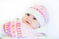 Little baby girl in a pink hat and scarf funny Stock Images