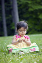 Little baby girl playing in clover grass Royalty Free Stock Image