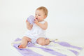 Little baby girl playing with threads ball. Royalty Free Stock Photo
