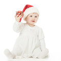Little baby girl in Santa's hat playing Royalty Free Stock Photos
