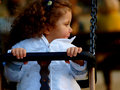 Little baby girl on see saw Royalty Free Stock Image