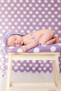 Little baby girl sleeping on a chair with hat Royalty Free Stock Photography