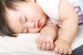 Little baby girl sleeping close up Stock Photos