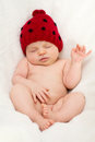 Little baby girl sleeping with cute ladybug hat Royalty Free Stock Photo